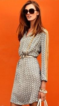 Classic summer office wear: light weight dress, little belt, chunky jewelry, and large sunglasses
