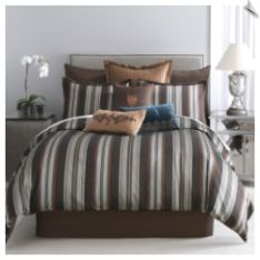 Modern Living Pearse Bedding Set. This set includes a yarn-dyed woven comforter, matching shams, and bedskirt. The comforter and shams feature classic stripes in shades of brown, rust, tan, and pale blue. The brown trim and bedskirt pull the look together beautifully. #comforter #bedding #duvet #masculine #stripe