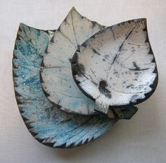 Unique handcrafted Raku leaves in the shape of birch leaves. Birch is known as…