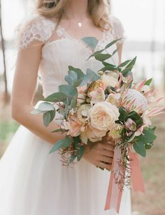 relaxed bouquet with roses and protea
