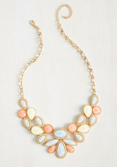 Having perfected your career-making aria, you clasp the golden chain of this statement necklace about your neck to truly shine on stage! As you sway through a solo, the glistening pastel faux stones of this colorful accessory - accented by golden trim and ivory beads - twinkle in the spotlight.