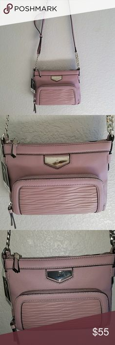 """Vera Wang plum contemporary Easton crossbody Vera Wang plum contemporary Easton crossbody  7"""" height by 9"""" width zip outer pocket  zip top with one zip pocket and one open pocket inside Simply Vera Vera Wang Bags Crossbody Bags"""