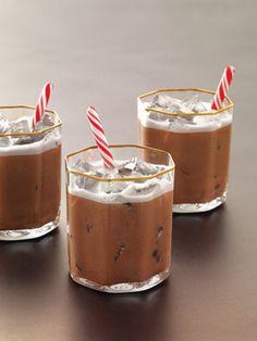 The North Pole: 1½ oz. Grey Goose Cherry Noir Flavored Vodka,  ½ oz. peppermint schnapps,  1 oz. heavy cream,  1 oz. chocolate syrup,  Garnish: mini candy canes