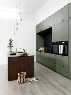 Large green kitchen wall with dark wooden island, kitchen with four . - Large green kitchen wall with dark wooden island, kitchen with lots of storage space, modern kitchen - Kitchen Inspirations, Interior, Home, Kitchen Island Lighting, Modern Kitchen, Home Remodeling, Green Kitchen Cabinets, Modern Interior Design, Kitchen Style