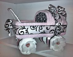 I am obsessed! Carriage Diaper Cake Pink With Black & White Damask Print.  Name Embroidered On The Bib For Free.  Can Be Made In Other Colors.