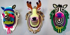 This makes me giggle. Crocheted Faux Taxidermy. Is it weird I think this is super cute and it is totally something I would put in my house!? It would be cute in a little girl's room that was safari themed or something . :)