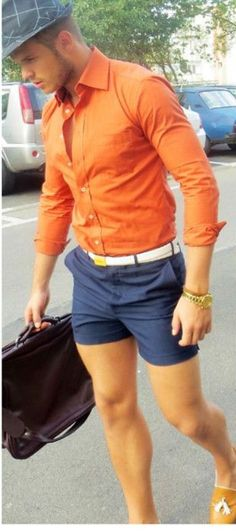 Try teaming an orange button-down shirt with deep blue shorts for a comfortable outfit that's also put together nicely. Khaki leather tassel loafers will add elegance to an otherwise simple look. Shop this look on Lookastic: https://lookastic.com/men/looks/long-sleeve-shirt-shorts-tassel-loafers-messenger-bag-hat-belt-watch/11575 — Charcoal Plaid Hat — Orange Long Sleeve Shirt — White Leather Belt — Gold Watch — Navy Shorts — Dark Brown Leather Messenger Bag — Tan Leather Tassel Lo...