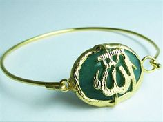 Stylish and classic! Our dark green stone gold plated Allah name bangle bracelet looks awesome against denim, white and black shades! This will make the perfect addition to your Allah jewelry collection! Price: $34.85  #allahbracelet #islamicbracelet #muslimjewelry #allahcharmbracelet #arabicbracelet #arabicjewelry #allahloversjewelry