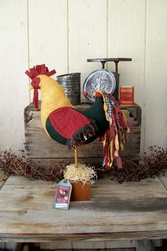 This is a Primitive Folk Art Patchwork Rooster Doll Makedo This piece would display nicely as a centerpiece shelf sitter or placed on a bureau table or halltree The rooster Primitive Folk Art, Primitive Crafts, Goose Craft, Chicken Barn, 3d Quilts, Chicken Crafts, Arte Country, Textile Sculpture, Rooster Decor