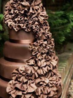 Love this chocolate wedding cake with ruffle cascade.
