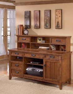 the cross island home office desk from ashley furniture homestore the richly detailed mission design of the cross island home office collection captures arts crafts home office