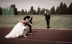 Funny wedding picture for a couple who run - and that's their wedding priest with them!