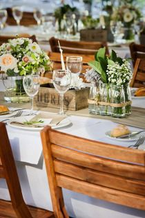 ADORE these table settings - fresh herbs, glass jars, brown butcher paper runner.