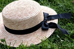 Straw hat with a black ribbon