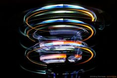 Moving down the tripod twice  creates multiple lightpainting rings with blades.  I created this with the new KYO adapters and 7 blades on three different torches in action, SOOC. I love the futuristic results. Photo ©2018 by Chris Noelle - lightwriting.de Settings: Canon 7D, 18 sec. exposure, F9, ISO100, 18-135mm@18mm #lightblading #liteblades #lightpainting #art #lightwriting #lightart #lpwa #lpwalliance #longexposure #bulb #slowshutter #fubiz #lightpaintingblog #picoftheday… Light Writing, Slow Shutter, Torches, Long Exposure, Light Art, Tripod, Futuristic, Canon, Bulb