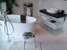 Whytes of Monifieth window display featuring the ios free standing bath and ios 54 basin.