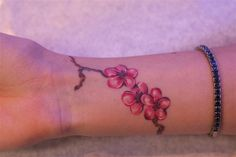 Cherry blossom tattoo.. so pretty and simple