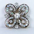 Femininity defined!  Beautiful opals and diamonds in a delicate cloverleaf brooch dating to the 19th Century.