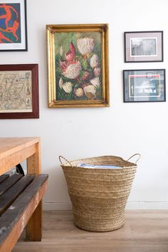 """The large oil painting of the proteas was found in a locked cupboard in a house that Jean's parents bought on a lake in White River. """"I have no idea who the artist is or its history. I just love the mystery of this piece and its over-the-top gold frame,"""" says Jean. The basket is from the Maputo Central Market in Mozambique."""