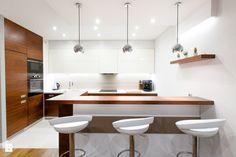 Mieszkanie w Poznaniu - Duża otwarta kuchnia w kształcie litery l z wyspą - zdjęcie od Zastol.pl