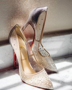 Hint of color and subtle sparkle | @louboutinworld  . . . . . . . #christianlouboutin #color #weddingshoes #sparkle #reception #shoes #tuesdayshoesday #shoelover #shoeaddict #stylist #gold #glitter #bride #love #ido