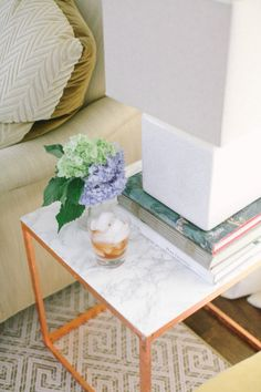 Create an upscale DIY marble and copper look with the IKEA PS side table like our fan at 'Style Me Pretty' blog!