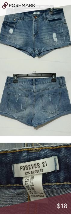 Forever 21 -Los Angeles- Distressed Jean Shorts 30 The hunt for the perfect pair of denim shorts ends here. Brand new never worn!   This pair of low-rise cutoffs features a distressed front for a lived-in look. It's just what you need for beach days, concerts, and everywhere in between.   Five-pocket construction, zip fly.  Super soft woven 75% cotton, 19% polyester, 6% rayon.  Machine wash warm.   Laying flat-   waist is 16 inches.   Length is 10.5 inches.   Inseam is 2.5 inches. Forever 21…