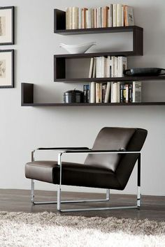 Gurian Harper. Designed by Zeno Nugari, this armchair is a classic: a combination of luxurious leather and chrome arm/seat surround, all built on a solid wooden frame (under the upholstery). In black (but available in other colours).