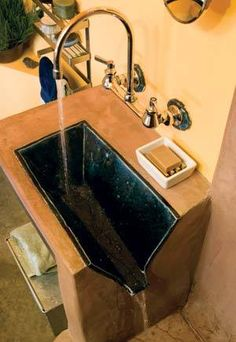 No need to plumb a tiny bathroom sink - just make it drain into the shower or tub!