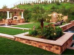 I like the way this yard mixes modern design with rustic stone work!