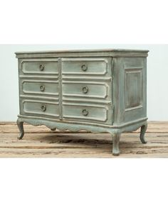 Featuring reclaimed wood and distressed paint, this console table brings vintage style straight from the French countryside. Hidden behind doors crafted to look like drawers is an adjustable shelf for storage. French Console Table, Classic Bathroom Furniture, Interior Stair Railing, French Country Style, Furniture, Simple Dresser, Furniture Assembly, Farmhouse Furniture, Chest Of Drawers Makeover