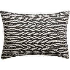 "Shop 18""X12"" Dash Black and White Pillow.   Graphic black and white pattern of imperfect hash marks reminds us of vintage mudcloth without the crushing price tag.  Patterned front flips to solid neutral back."