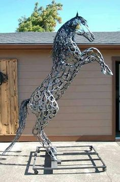 & - sculpted from recycled horseshoes by Bud Thomas of Oregon Horseshoe Art; he has a & mane and fierce & - sculpted from recycled horseshoes by Bud Thomas of Oregon Horseshoe Art; Horseshoe Projects, Horseshoe Crafts, Horseshoe Art, Metal Tree Wall Art, Scrap Metal Art, Metal Artwork, Tree Artwork, Sculpture Metal, Horse Sculpture