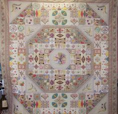 This quilt is my favorite,I made this is a class at Blueberries with Karen Cunningham...this is her adaptation of Sundial Sampler...hand pieced and hand quilted by me...Such a treasure!