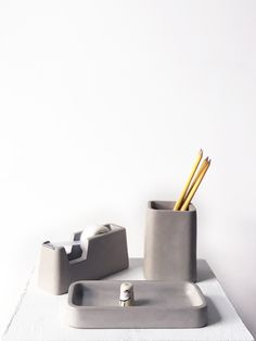 Getting organized is often as simple as having the right tools. With the Concrete Desk Set everything has its place. Cast from solid concrete, the set includes a tape dispenser, pencil holder, and a s