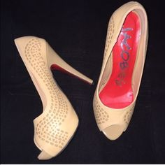 Tan Red Sole Pumps Only worn once. Did find little scuffs on back, especially right shoe, barely noticeable (see pictures), soles a little used (see pictures). Comes with an extra pair of heel taps and original box. Shoes Heels