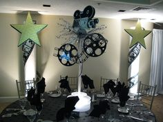 Cardboard movie reels spray painted black