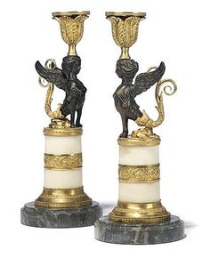 A PAIR OF RUSSIAN ORMOLU AND PATINATED-BRONZE CANDLESTICKS