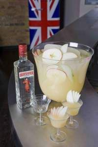 Beefeater Garden Party Punch - 3 parts Beefeater London Dry Gin, 3 parts Sparkling English Wine, 2 parts Good Quality Pressed Pear or Apple Juice, 1 part Fresh Lemon Juice, 1 part Elderflower Cordial, ½ part Sugar Syrup, Pear and apple slices. Stir all ingredients with a large ice block and serve with ice in a highball glass. For large ice block: filling a clean, empty juice carton three quarters full with water and freezing. When frozen, carefully cut carton away from the ice.