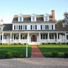 white house. big porch. That's about all that can be said.  I think this is so boring, so expected , so common.  Especially where I live in Virginia.  Center hall colonials are so overdone.