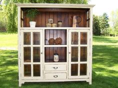 A tacky old entertainment center could TOTALLY be remade to look like this! by Hillary Gunn