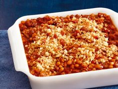 These Baked Beans with Bacon get topped with a bacon-breadcrumb mixture to make an irresistible crunchy topping.