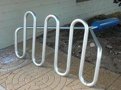 Bike Rack by Claus Oldenburg Bike Parking Rack, Bike Rack, Bike Repair Stand, Claes Oldenburg, Soft Sculpture, Sculptures, Outdoor Art, Land Art, Cool Bikes