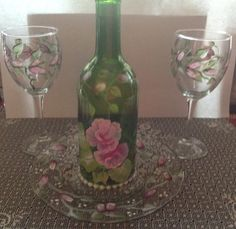Hand painted candle holder out of recycled wine bottle.