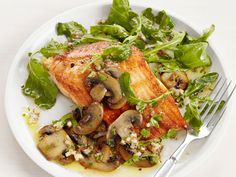 Arctic Char With Mushrooms : This crispy fish takes only about six minutes to cook, and a simple shallot-mushroom sauce and light arugula salad round out the dish with layered textures and flavors.