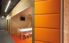 We are a global and creative design studio in Geneva, Tokyo and Beijing. Interior Architecture, Interior Design, Orange Design, White Chairs, Plywood, Offices, Creative Design, Identity, Stairs