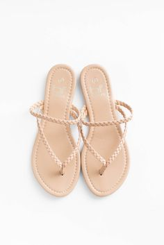 Simple nude flat sandals with a braided strap upper. Lightly padded insole. True to US size. Made in with all man made material Imported