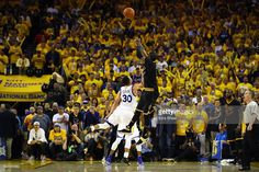 Kyrie Irving #2 of the Cleveland Cavaliers shoots a three-point basket late in the fourth quarter against Stephen Curry #30 of the Golden State Warriors in Game 7 of the 2016 NBA Finals at ORACLE Arena on June 19, 2016 in Oakland, California.