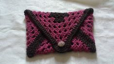 One of my current projects, this is an absolute work-in-progress. I'm currently looking for a suitable lining and perhaps a better button. I think it's going to be great as a make-up bag, or tablet bag, even a pencil case, mini-yarn stash, and lots more. Crochet Clutch Bags, Yarn Stash, Things To Think About, Pencil, Etsy Shop, Blanket, Button, Mini, Projects