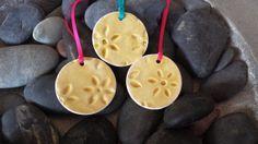 Three small ceramic Christmas tree decorations in honey crackle glaze